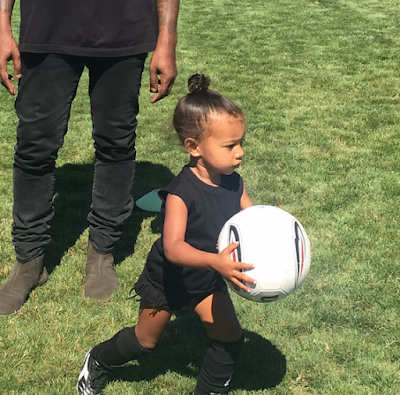 Kim Kardashian shares pictures of daughter playing football
