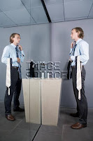 Man comparing ties in a mirror