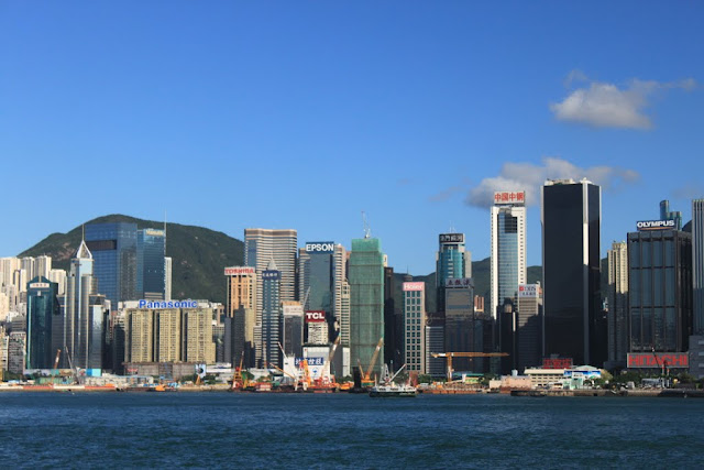 Modern architectural skyline buildings along Victoria Harbour in Hong Kong