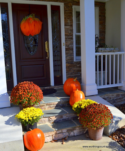 Fall front porch with mums, pumpkins and deco-mesh pumpkin via Worthing Court blog