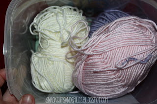 re-purposing a laundry detergent bucket into yarn storage