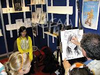 image photo : MARC PAGEAU CARICATURISTE AU FESTIVAL DE LA BANDE DESSINÉE FRANCOPHONE DE QUÉBEC 2010