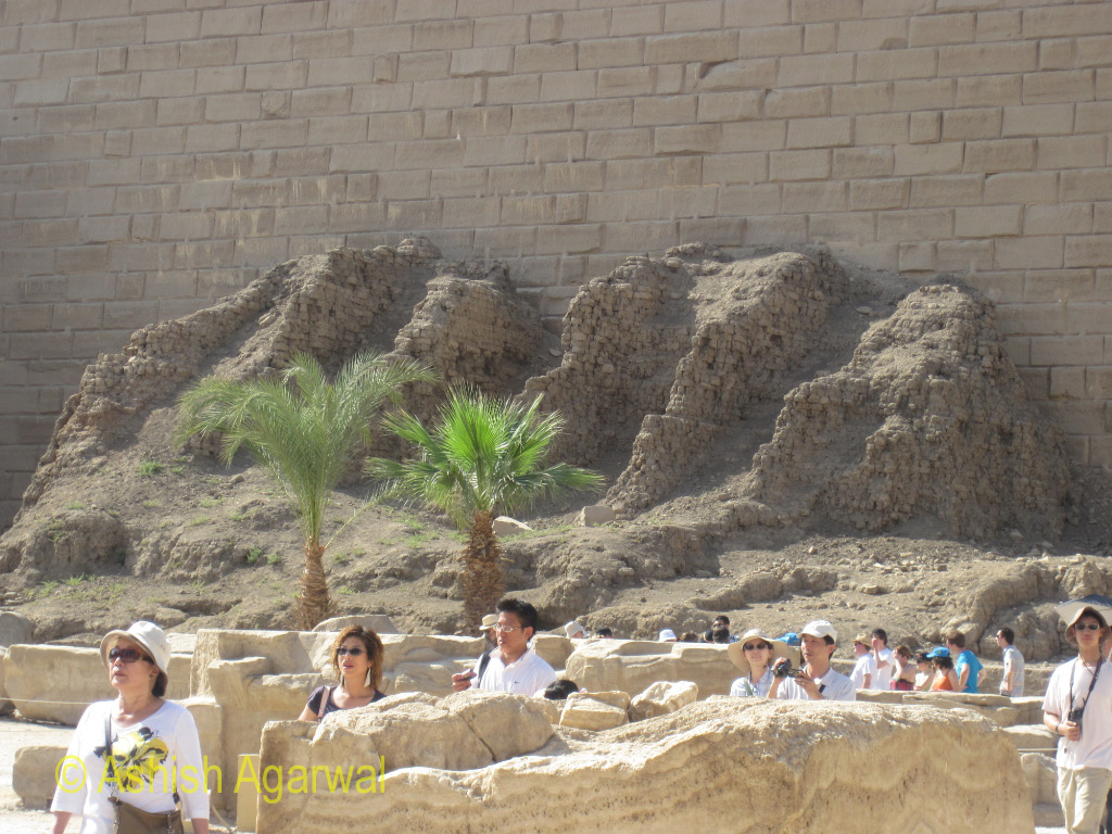 Tourists walking through the intial section of the Karnak temple in Luxor