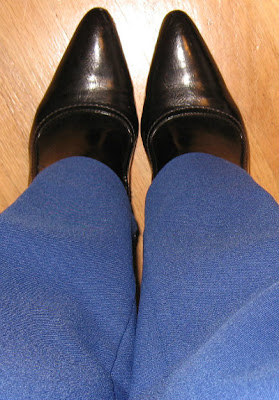 black booties with royal blue pants