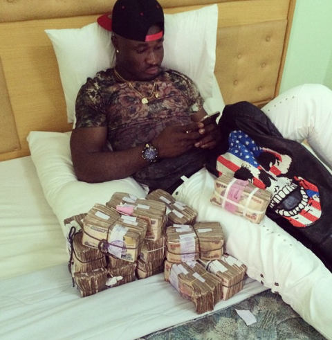 Nigerian Singer Harrysong Flaunts a Pile of Money on Instagram