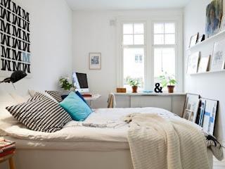 cozy scandinavian bedrooms 16 554x415 Dekorasi kamar tidur untuk cuaca dingin