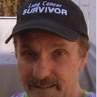 "baseball style hat embroidered with ""lung cancer survivor"""