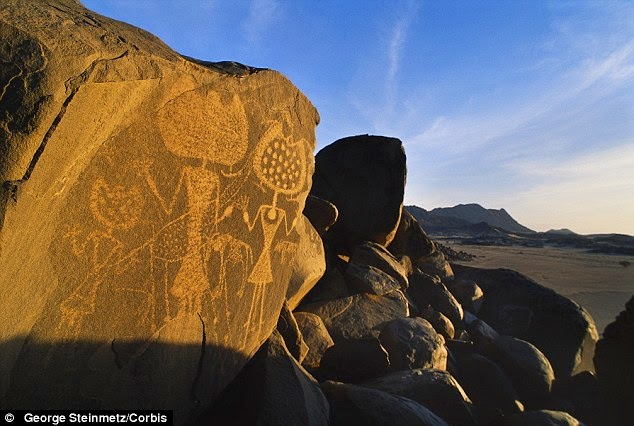 http://www.dailymail.co.uk/sciencetech/article-2634903/Have-aliens-visited-Earth-Nasa-book-suggests-ancient-rock-art-created-extra-terrestrials.html