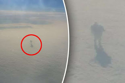 Plane passenger captures mysterious shadowy figure