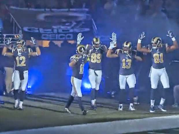 "Five St. Louis Rams Players on 11/30 display the gesture ""Hands Up Don't Shoot"" to show solidarity with Ferguson Peaceful Protestors."