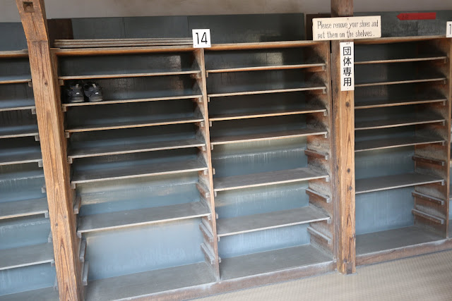 Visitors must remove their shoes and slip on Japanese houses  shoes that are provided before entering the Ninomaru Palace at Nijo Castle in Kyoto, Japan