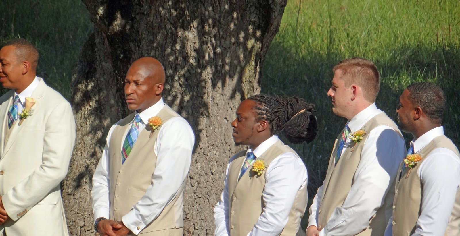 groomsmen with plaid ties