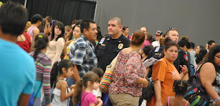 Austin ISD Police Chief Eric Mendez watches over parents and students during a back to school event.