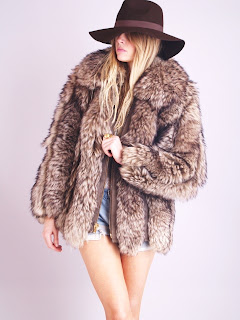 Vintage 1970's fluffy brown fur coat with zip front closure.