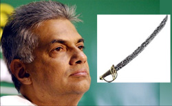 A sword found by the STF personnel beneath the stage in Mawanella where Ranil was to address