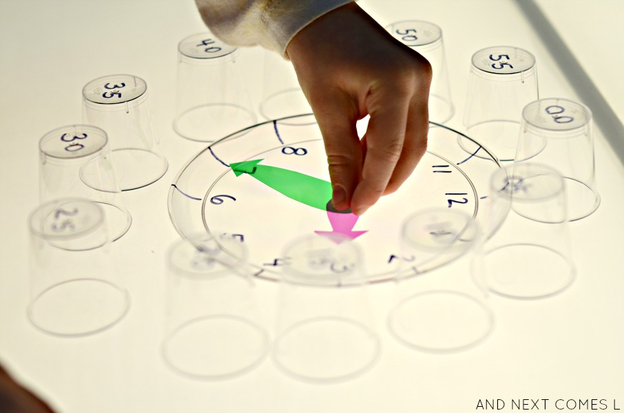 Clock light table activity that teaches kids how to tell time from And Next Comes L