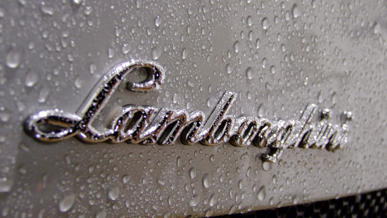lamborghini logo with water drops