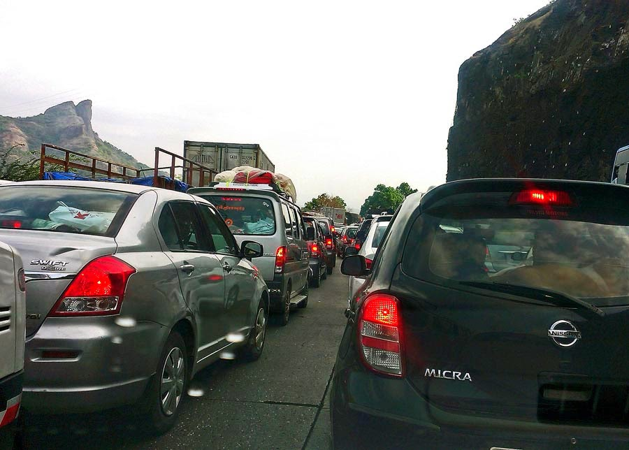 Rows of cars in a jam on the Mumbai Pune Expressway