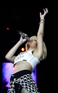 Rihana performing at Jingle Bell Ball in London onstage Spicy Rihana