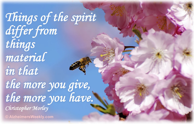 "Photo of bee in blossoms with the saying, ""Things of the spirit differ from things material in that the more you give, the more you have."""