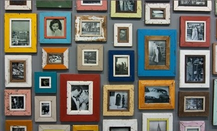 old battered frames of different shapes sizes and colours cant decide what pictures you want hung up on the wall hang them all up
