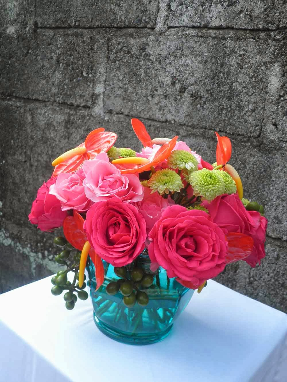 turquoise vase-hot pink rose, pink rose, red anthurium and green spra