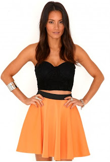 A shot of a model wearing a Missguided neon orange skirt