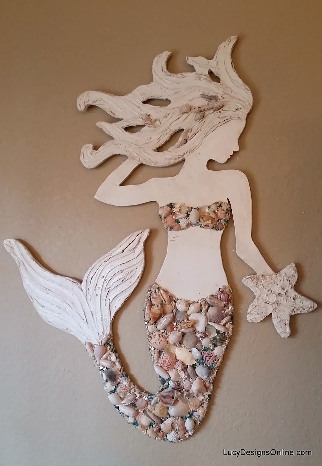 mermaid wall art with shells and glass