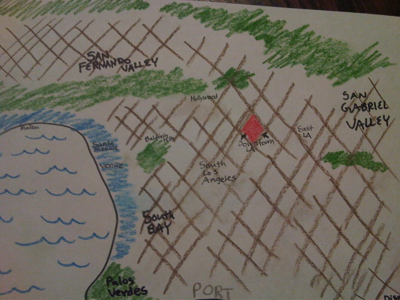 a map i doodled green is foothills blue is surfurbia brown lines are plains of id and the pink diamond is downtown la autopia is excluded