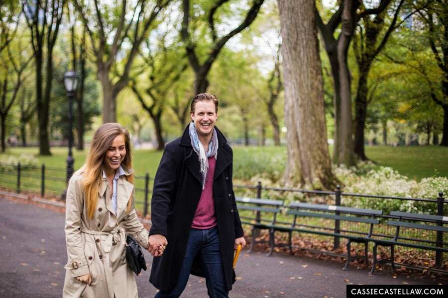 Laughing, happy couple walking down The Mall, Lifestyle Engagement Session in the fall Central Park NYC - www.cassiecastellaw.com
