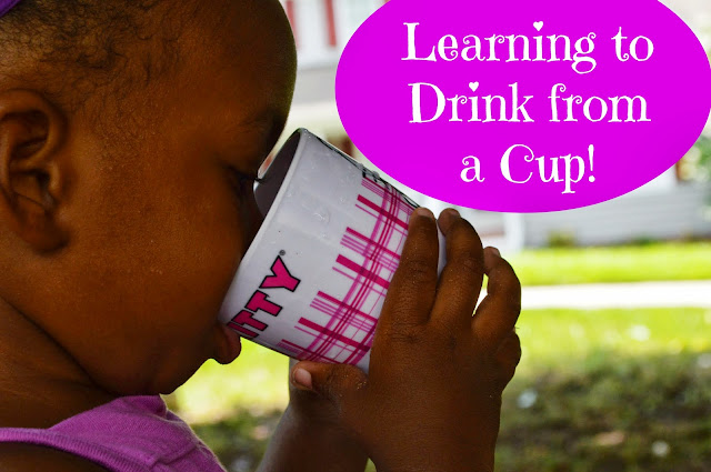 Teaching a toddler to drink from a cup