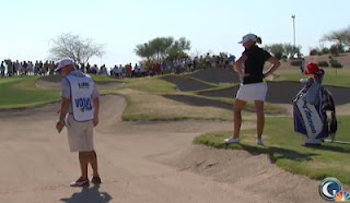 Stacy's caddie tests the sand