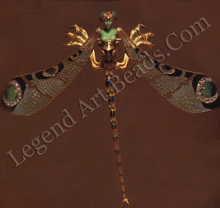 A dragonfly corsage ornament of gold, enamel, chrysoprase, moonstones and diamonds (c. 1897-98). This spectacular hybrid dragonfly of immense proportions and striking allusions to metamorphosis and female sexuality is perhaps the most memorable of Lalique's jewels: