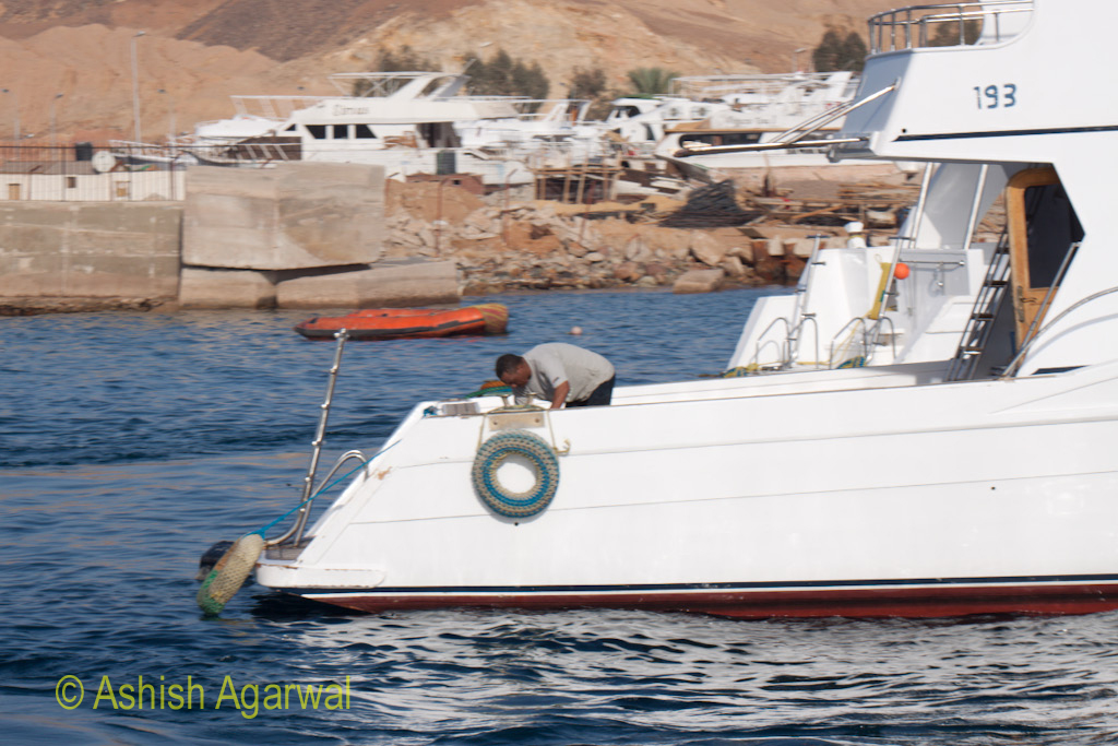 Staff member doing some work at the back of the ship in Sharm el Sheikh in the Red Sea