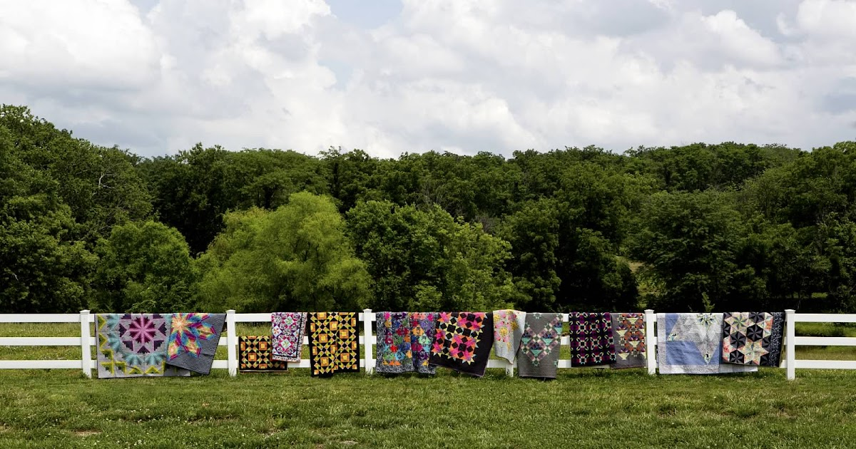 Amish Fence Posts : Amish inspired quilts on a fence
