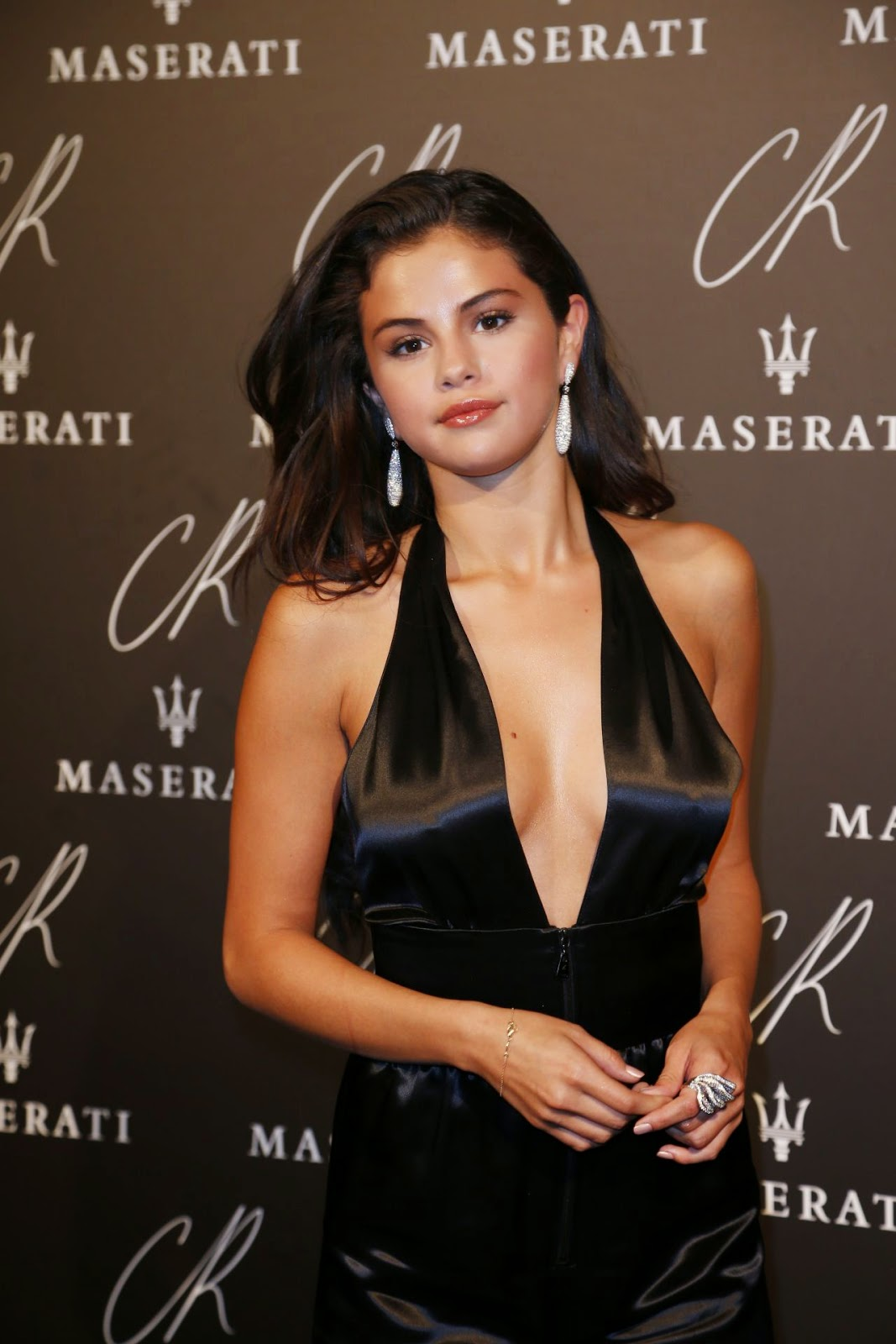 Selena Gomez wears a bold low-cut jumpsuit to the CR Fashion Book #5 Paris Launch Party