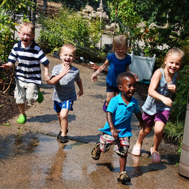 The kids happen to find a sprinkler in the outdoor garden over the sidewalk a bit. Such delinquent fun!