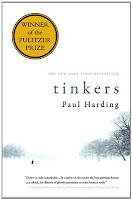 "Image: the cover of Tinkers. The cover is almost entirely white, and is a picture of a snowy landscape with some black trees and a very small silhouette of a person walking. The title and authors name are in black, and there is a gold sticker on the upper left-hand corner that reads ""Winner of the Pulitzer Prize."""
