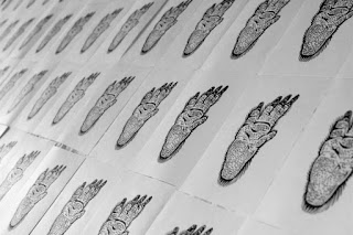 wombat foot linocuts drying
