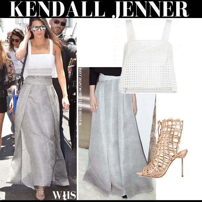 Kendall Jenner in white crop top 3.1 Phillip Lim, grey maxi skirt Sally Lapointe and metallic gladiator sandals Sophia Webster what she wore cannes may 20 spring summer style