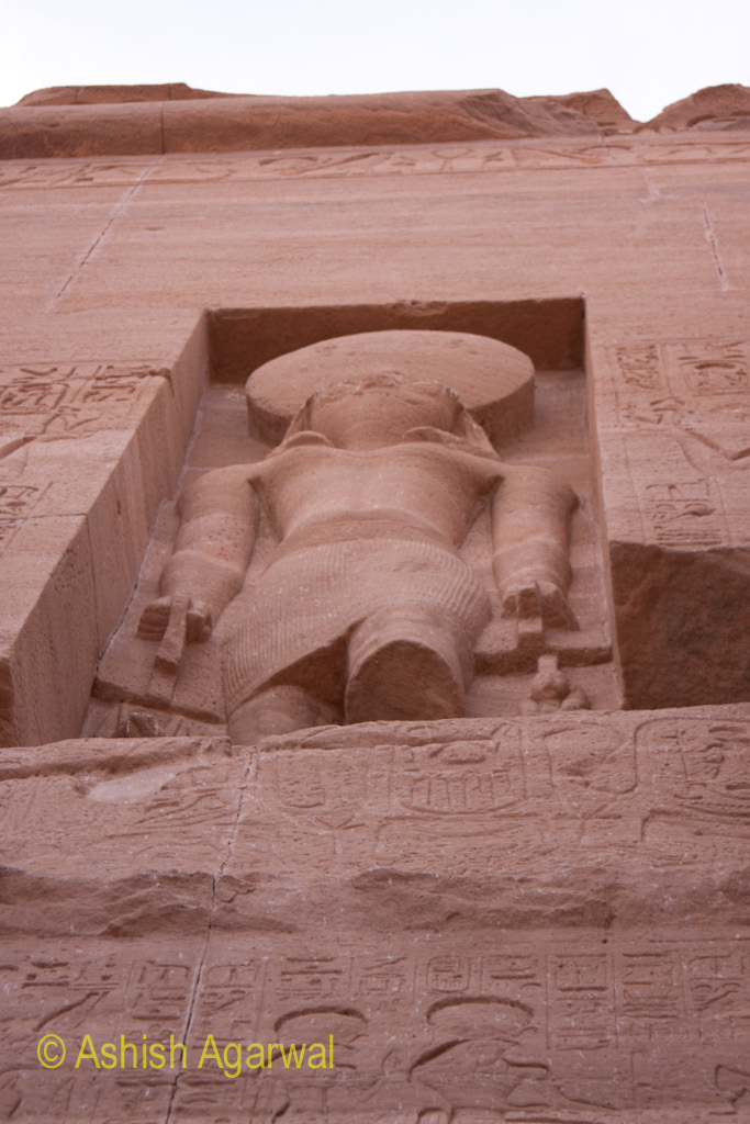 Statue on the wall above the entrance of the Abu Simbel temple in south Egypt