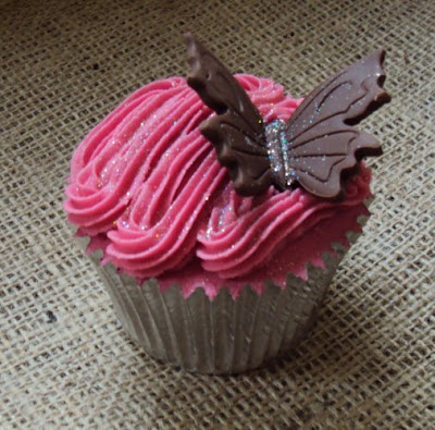 Pink frosted butterfly cupcake