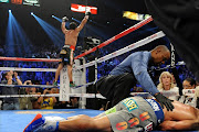 Pacquiao totally burst down the canvas after receiving right straight from .