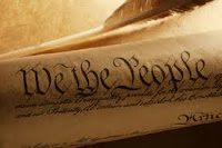 rolled scroll of constitution with the wordes WE THE PEOPLE