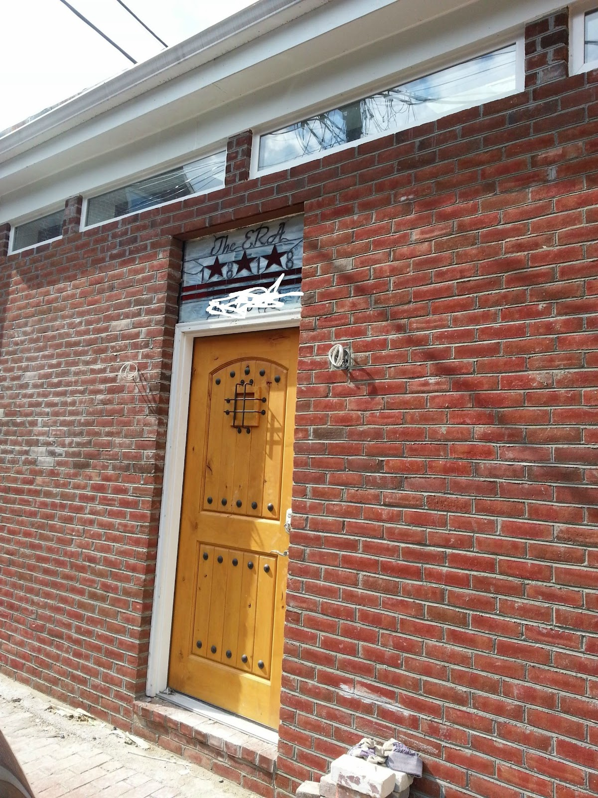 16-Brick-facade-imgur-Storage-Unit-Renovation-in-Tiny-Architecture-www-designstack-co