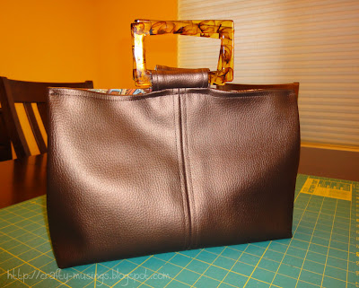 Faux leather handbag, front view