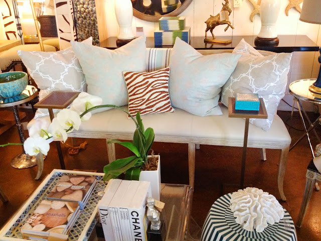 COCOCOZY Quatrefoil White and Oxford Sea Foam Natural Linen pillows on a settee in Mecox Gardens in Los Angeles, CA