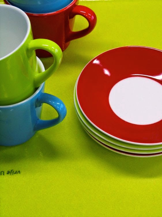 colorful cups and saucers