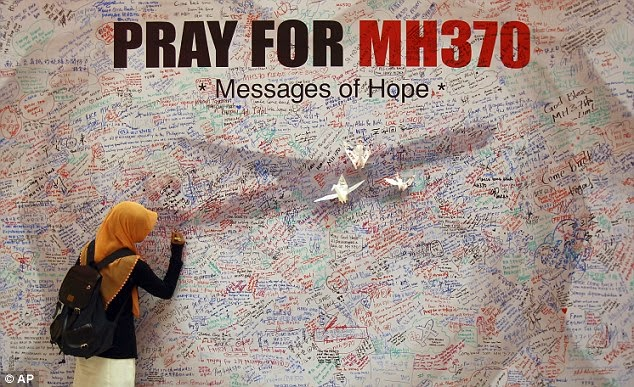 Thousands of people have written messages of support on a wall at a shopping mall in Kuala Lumpur, for passengers on board the missing Malaysia Airlines plane.
