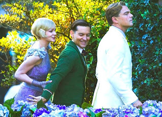 Leonardo Dicaprio, Tobey Maguire and Carey Mulligan in The Great Gatsby